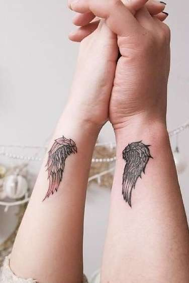 angel wings tattoo on wrist for girls