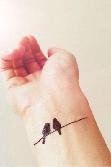bird tattoo on wrist for girls
