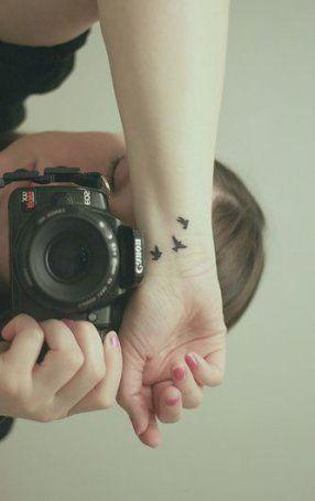 bird tattoo on wrist for females