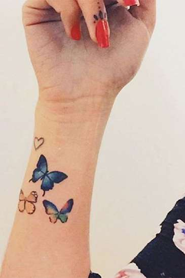butterfly wrist tattoo for females