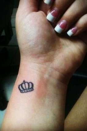 crown tattoo on wrist for women