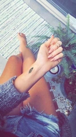 feather wrist tattoo for females