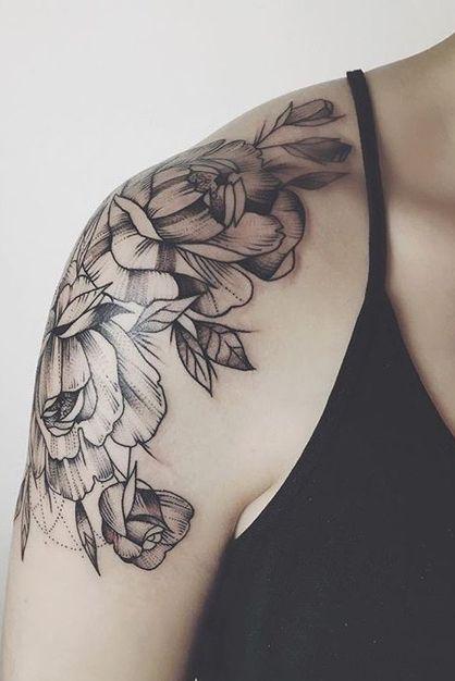 black floral shoulder cap tattoo