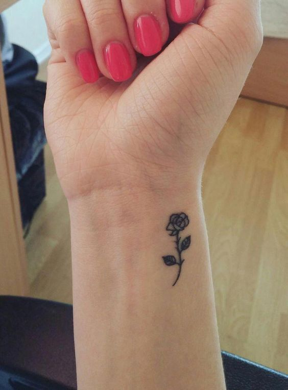 rose tattoo on wrist for women