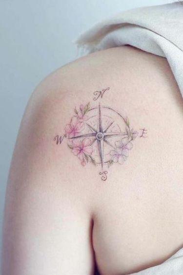 compass and flower mix tattoo