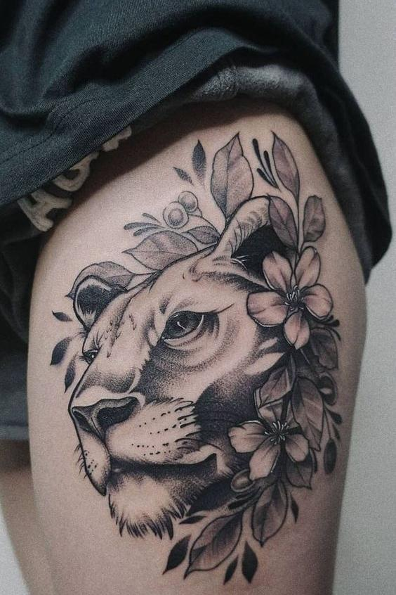 lion thigh tattoo design for females