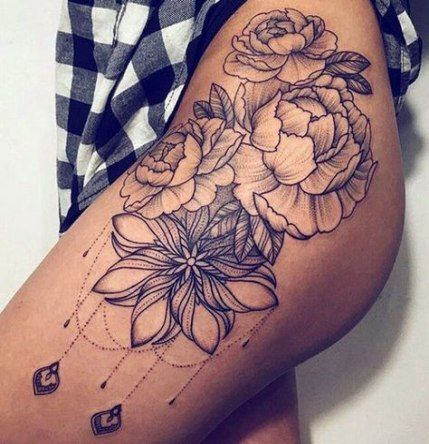 flower thigh tattoo for women