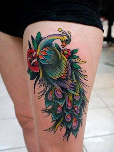 peacock tattoo on thigh