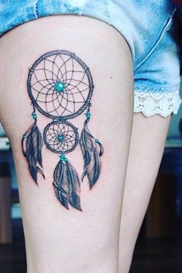dream catcher thigh tattoo for women