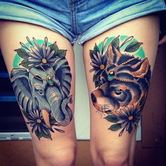 animal thigh tattoo