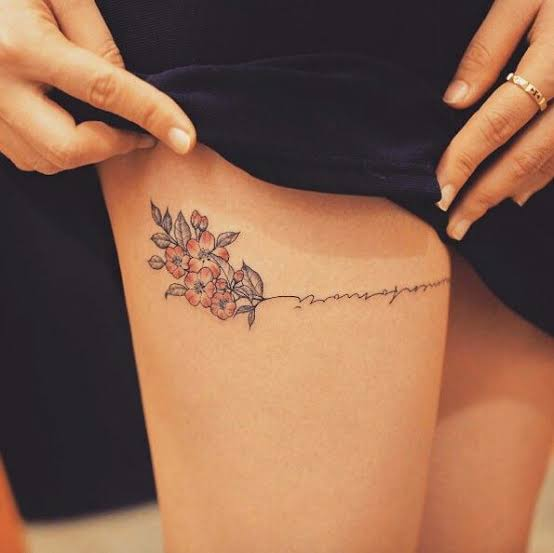 flower writing thigh tattoo