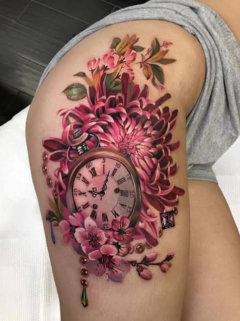 colorful thigh tattoo design