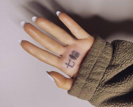 ariana grande tattoo 7 rings