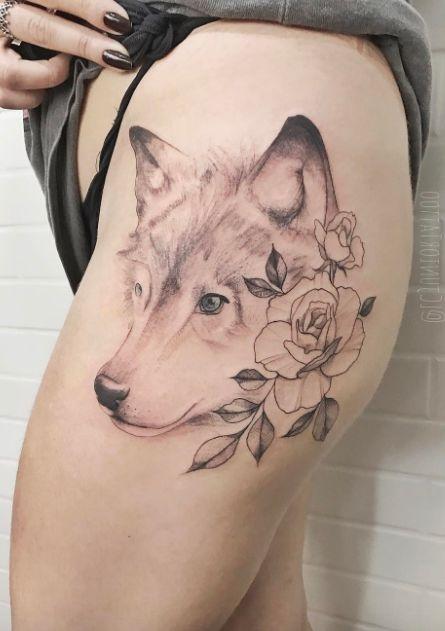 flower + wolf tattoo on thigh