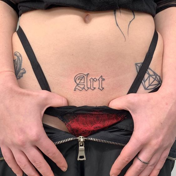 Words tattoo on stomach