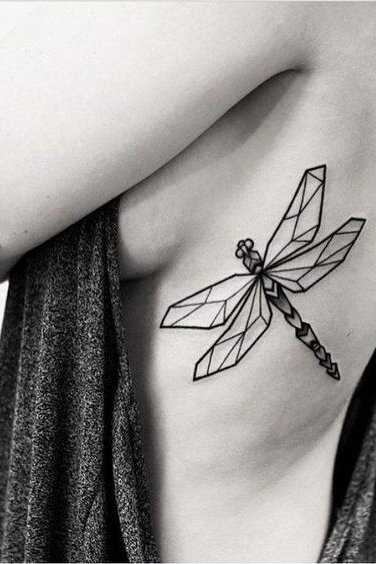geometric dragonfly tattoo on rib cage