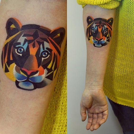 Geometric Tiger Face Tattoo on Sleeve