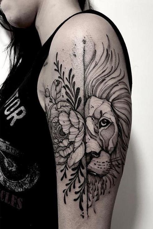 Flower + lion Tattoo on upper Arm
