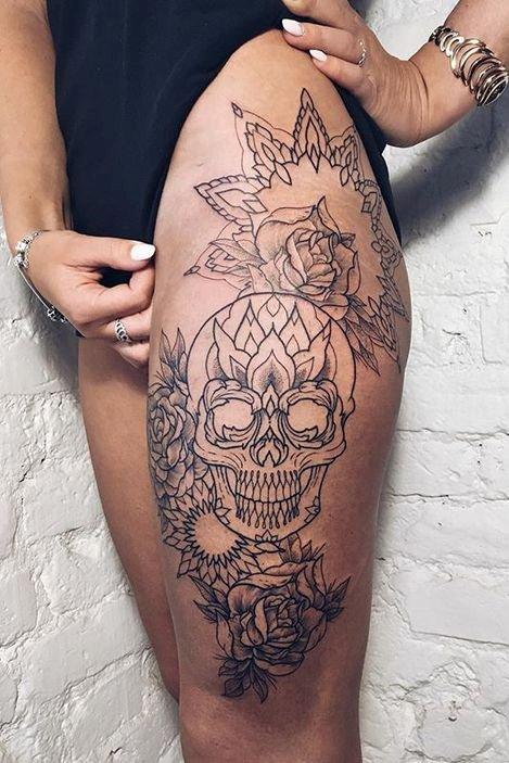 skull mix tattoo on thigh
