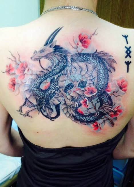 colorful dragon tattoo on Back
