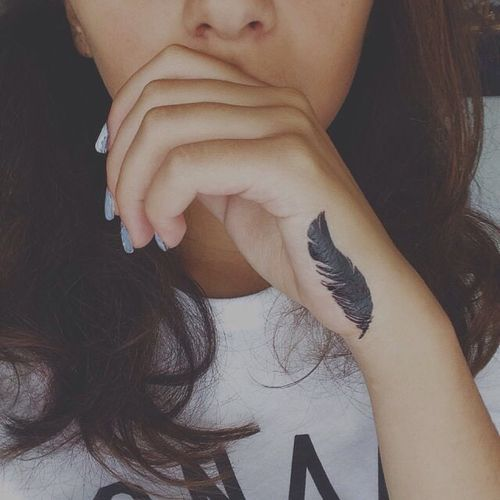 feather tattoo on hand