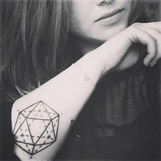 geometric tattoo on elbow