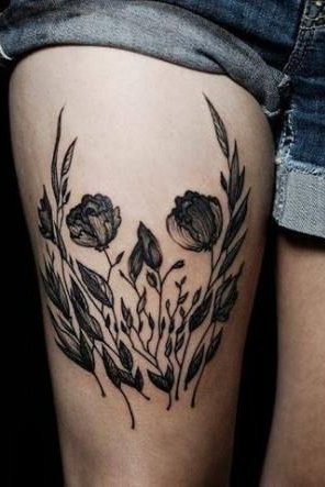 flower skull tattoo on thigh