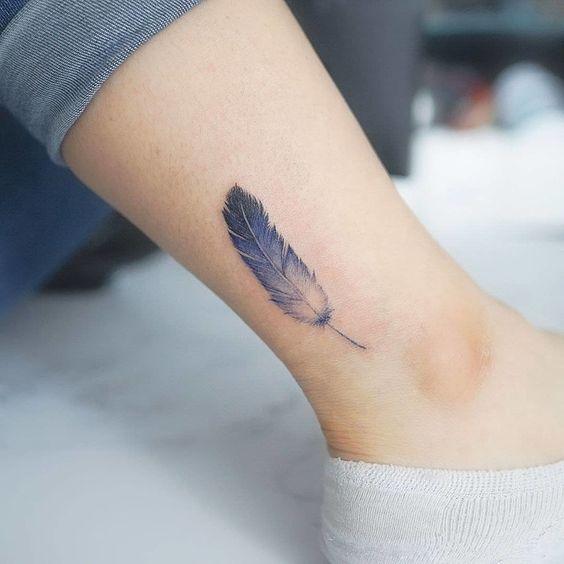 feather tattoo on leg