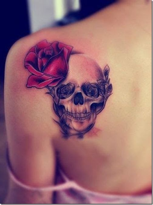 rose and skull tattoo on back
