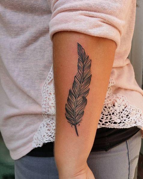 forearm feather tattoo