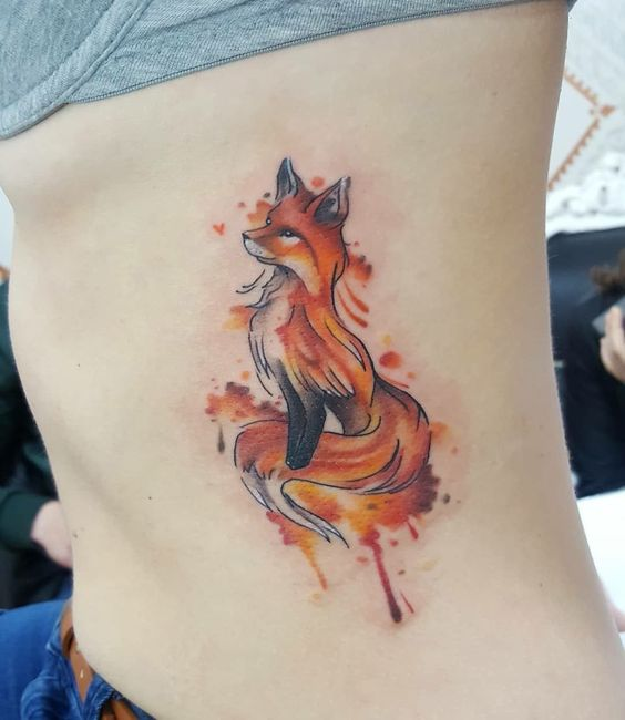 colorful wolf tattoo on rib