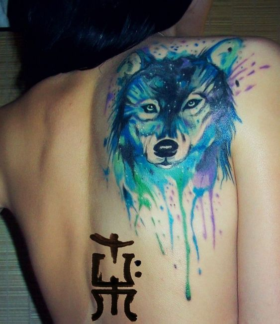 blue wolf tattoo on back