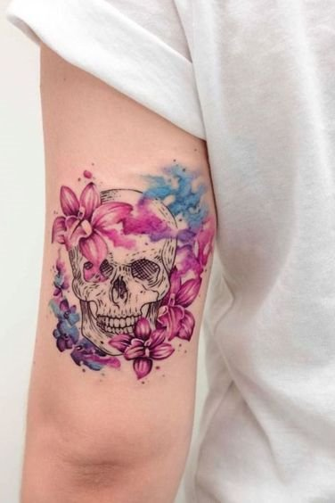 flower and skull mix tattoo on upper arm back side