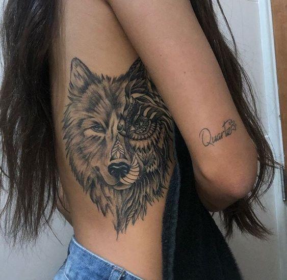 wolf tattoo on rib