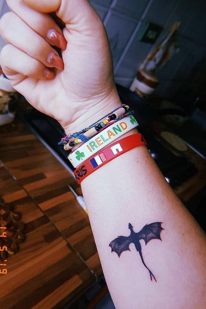 small dragon on wrist