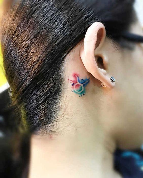 Color Taurus Tattoo behind ear