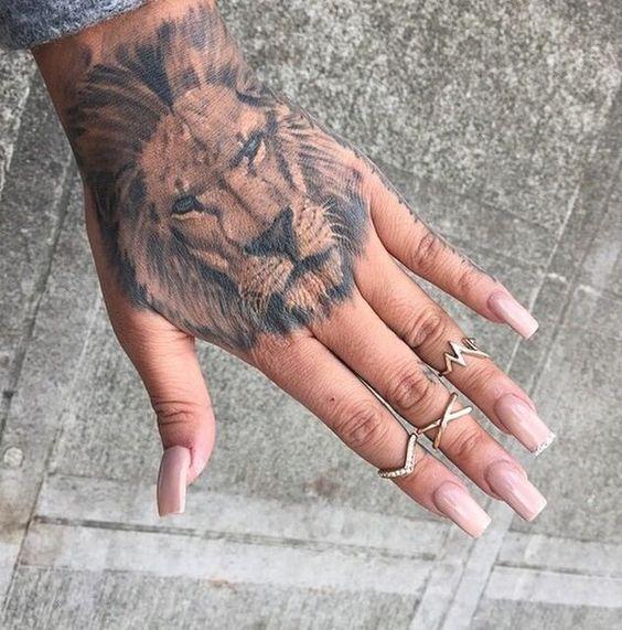 lion tattoo on hand