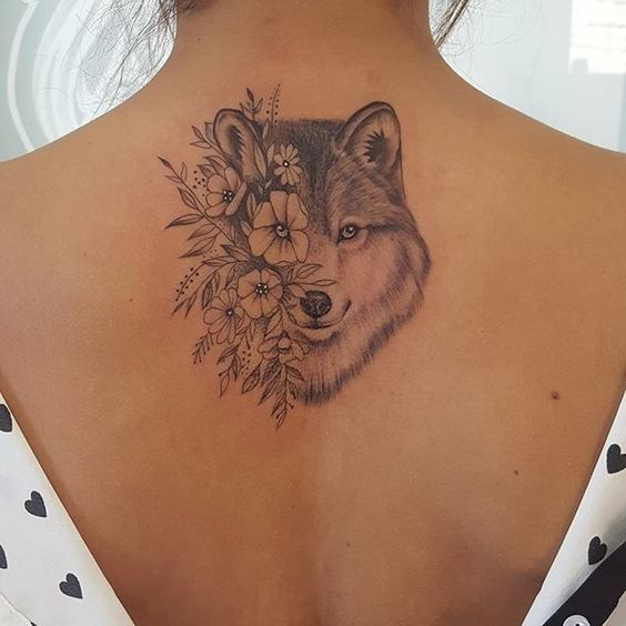 half face with flower wolf tattoo on back