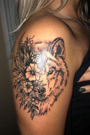 wolf tattoo on upper arm