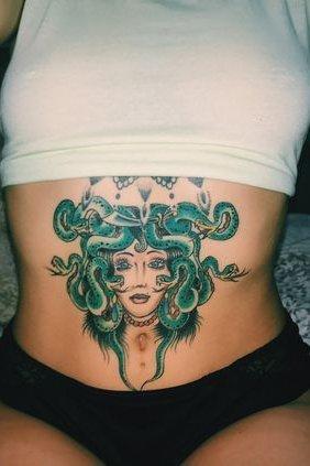 medusa tattoo on stomach