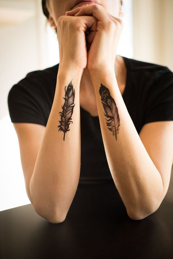 side wrist feather tattoo for women
