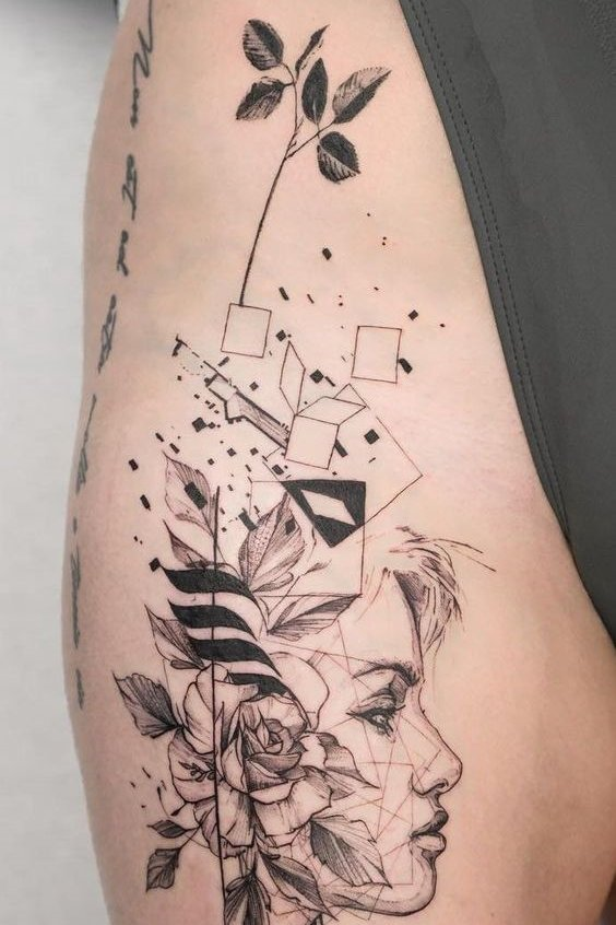 mix geometric tattoo on thigh