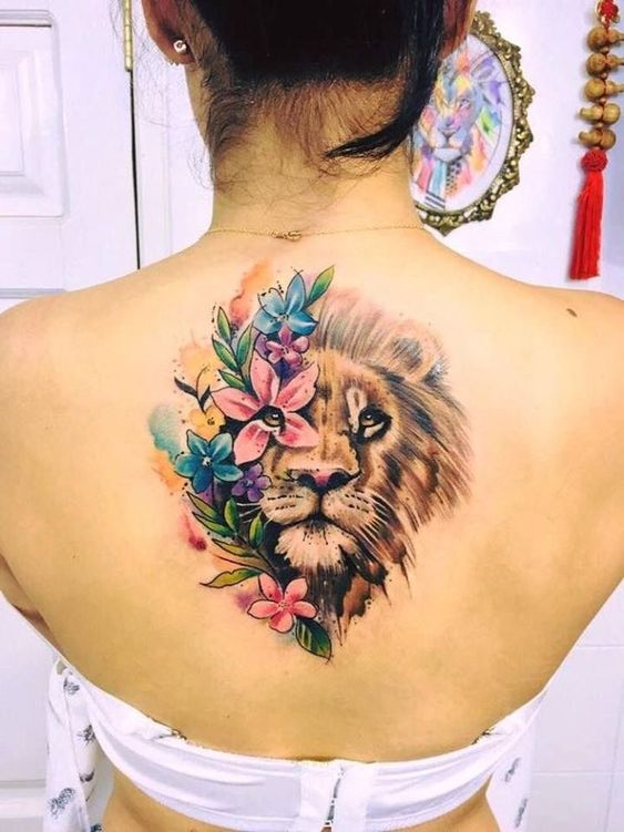 flower and lion tattoo on back