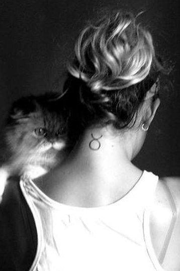 back neck Taurus tattoo