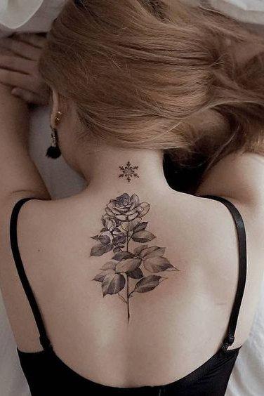 flower tattoo on back for females