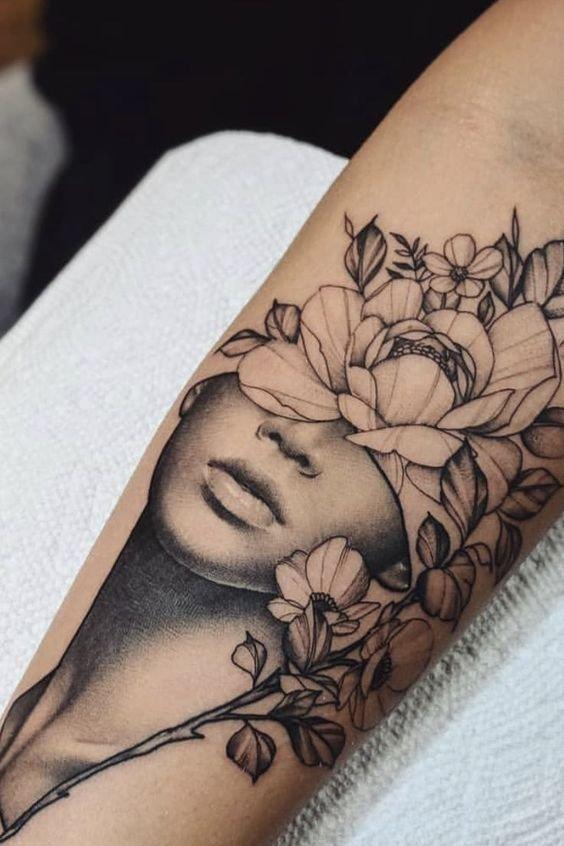 Flower tattoo on forearm