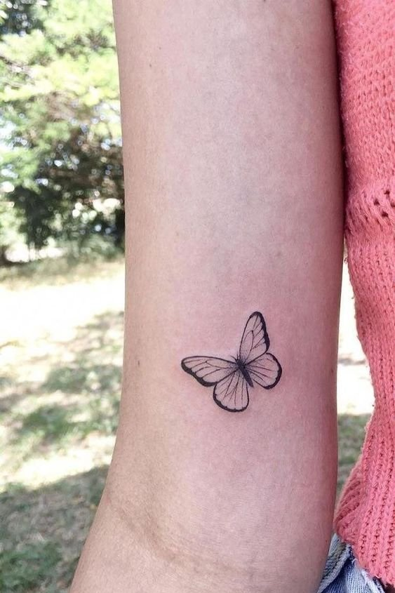 arm butterfly tattoo for females