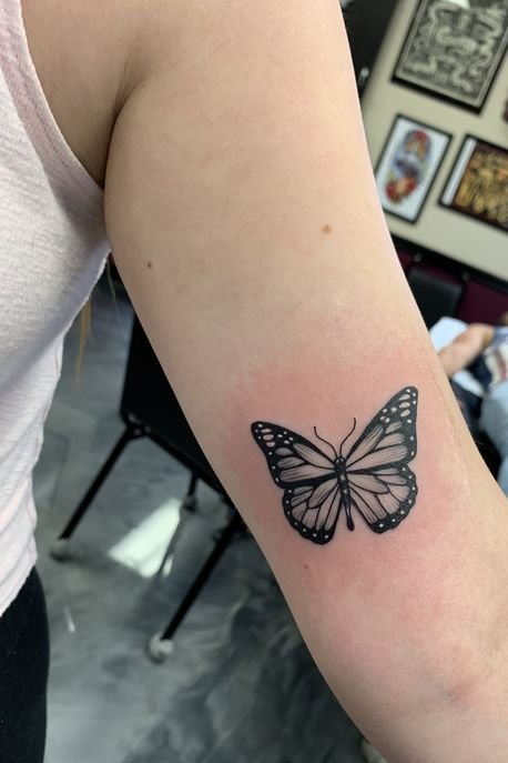 butterfly tattoo on upper arm