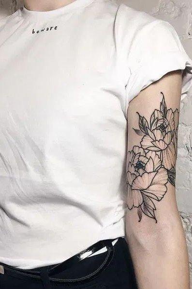 flower tattoo on upper arm