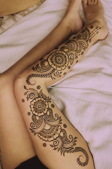 cute henna tattoo on thigh and leg